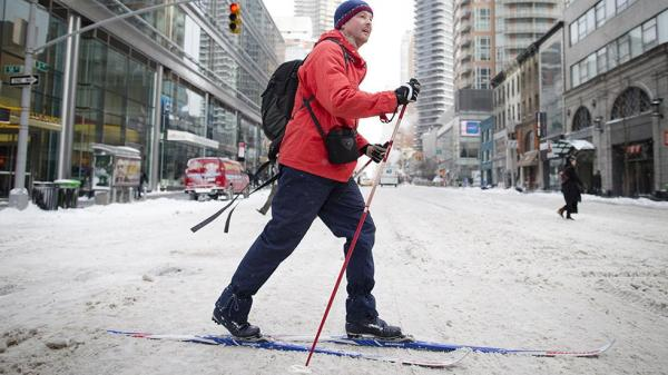 In New York, a man broke out the cross country skis for his commute through midtown.